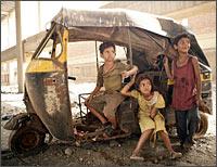 Ayush, Rubina Ali and Azhrauddin Mohammad Ismail in a scene from Slumdog Millionaire